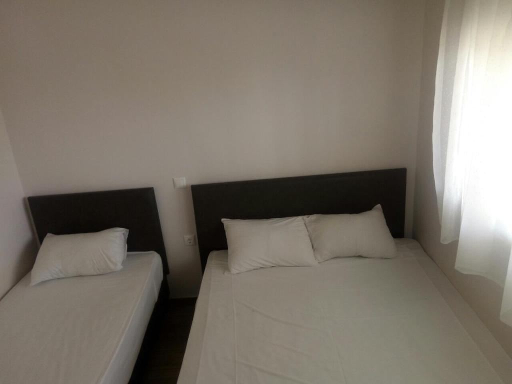 A bed or beds in a room at Villa Olympic Beach