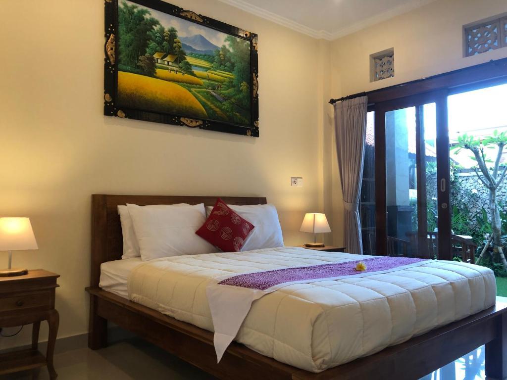 Cama o camas de una habitación en Taman Indah Homestay