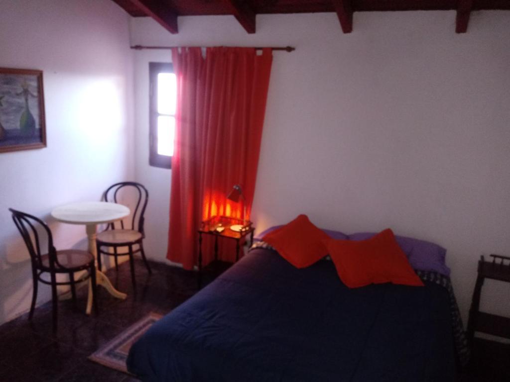 Una cama o camas en una habitación de Hostal Atix