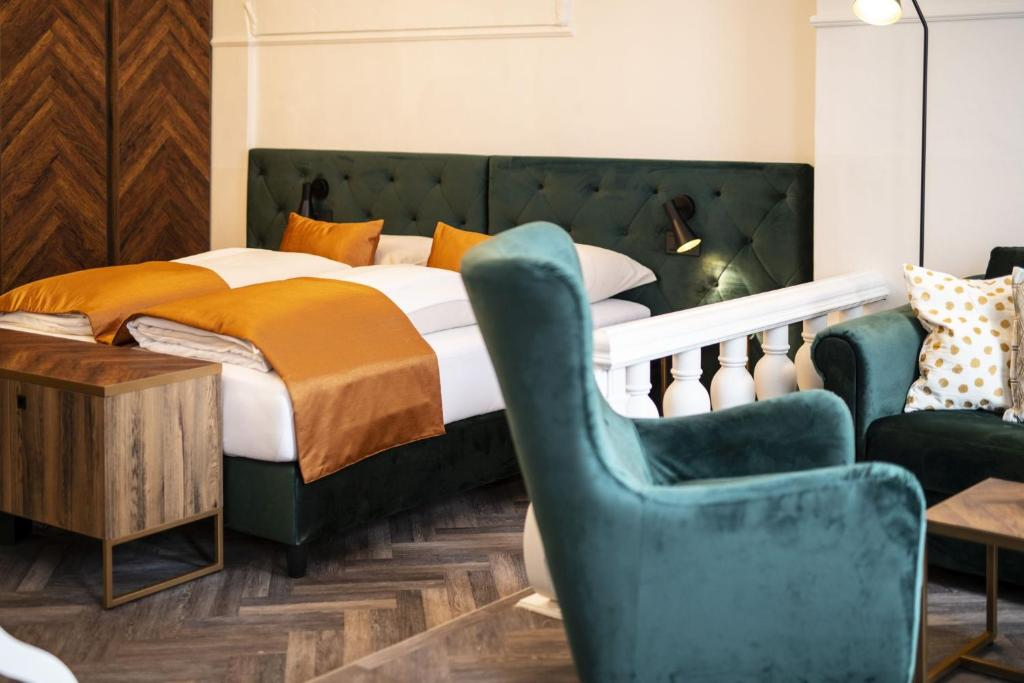 A bed or beds in a room at Hotel Palais26