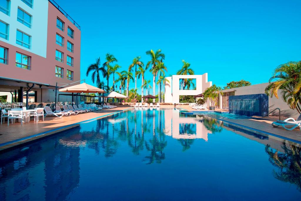 The swimming pool at or near DoubleTree by Hilton Esplanade Darwin