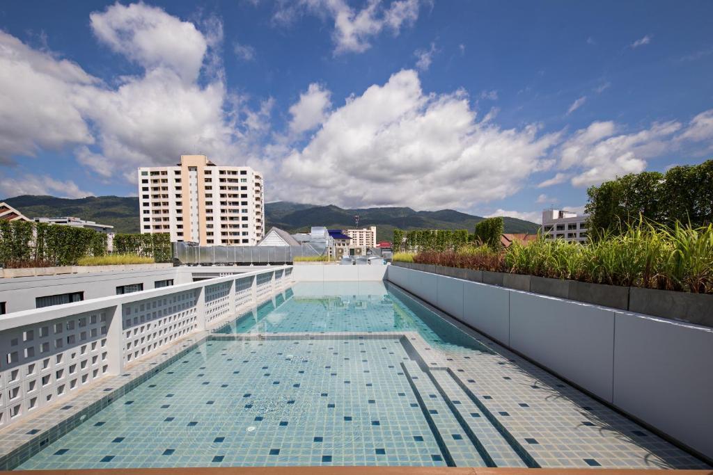 The swimming pool at or near Novotel Chiangmai Nimman Journeyhub