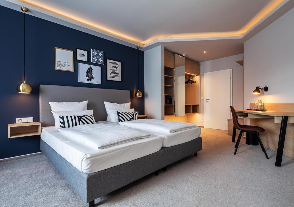 Ein Bett oder Betten in einem Zimmer der Unterkunft Hotel Wittorf