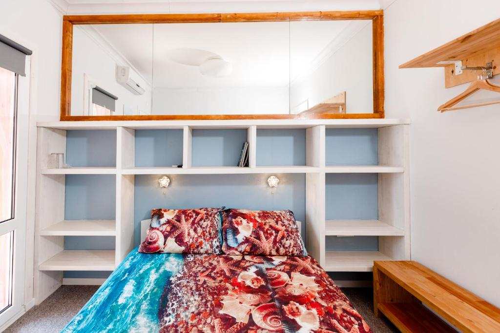 A bunk bed or bunk beds in a room at Zvezda