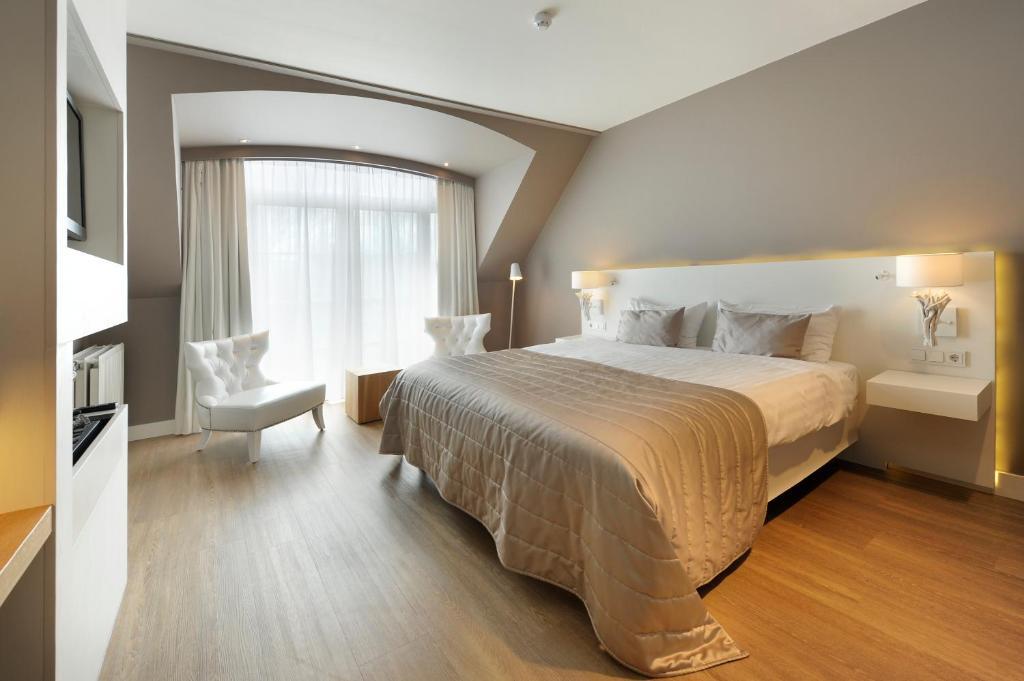 Letto o letti in una camera di Van der Valk Hotel Groningen Westerbroek