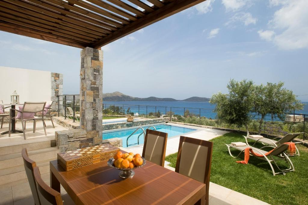 The swimming pool at or close to Elounda Olea Villas And Apartments
