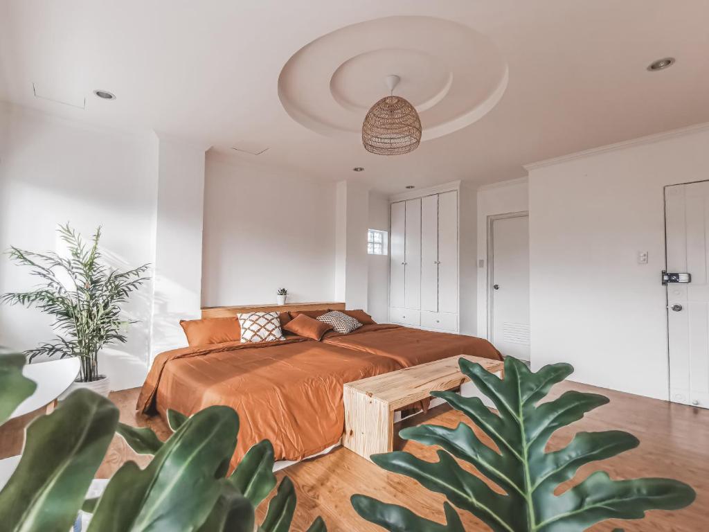 A bed or beds in a room at Murals Mactan