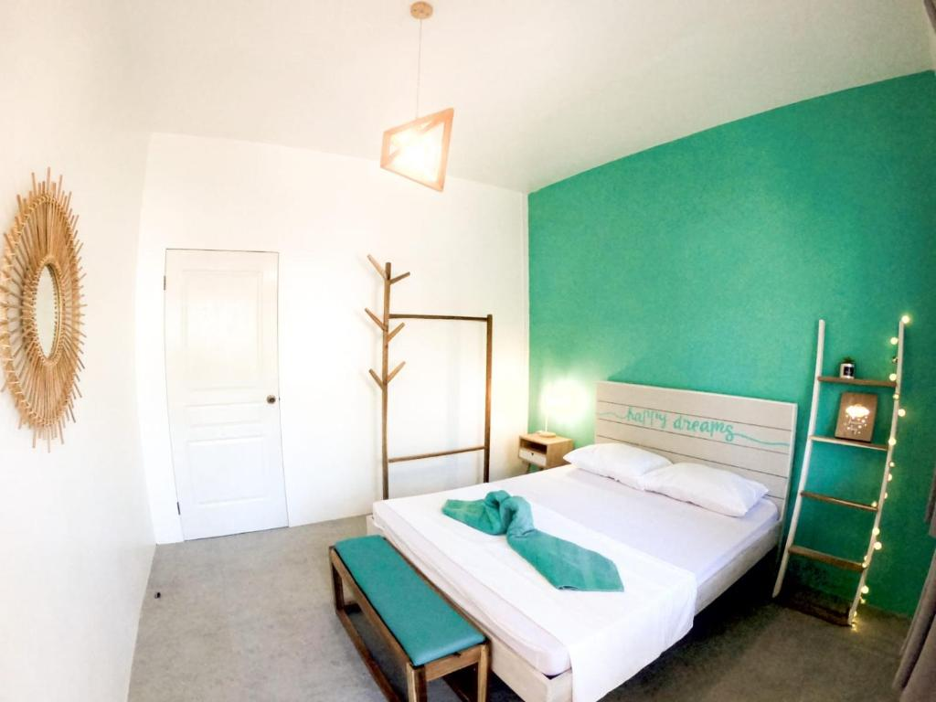 A bed or beds in a room at My Green Hostel