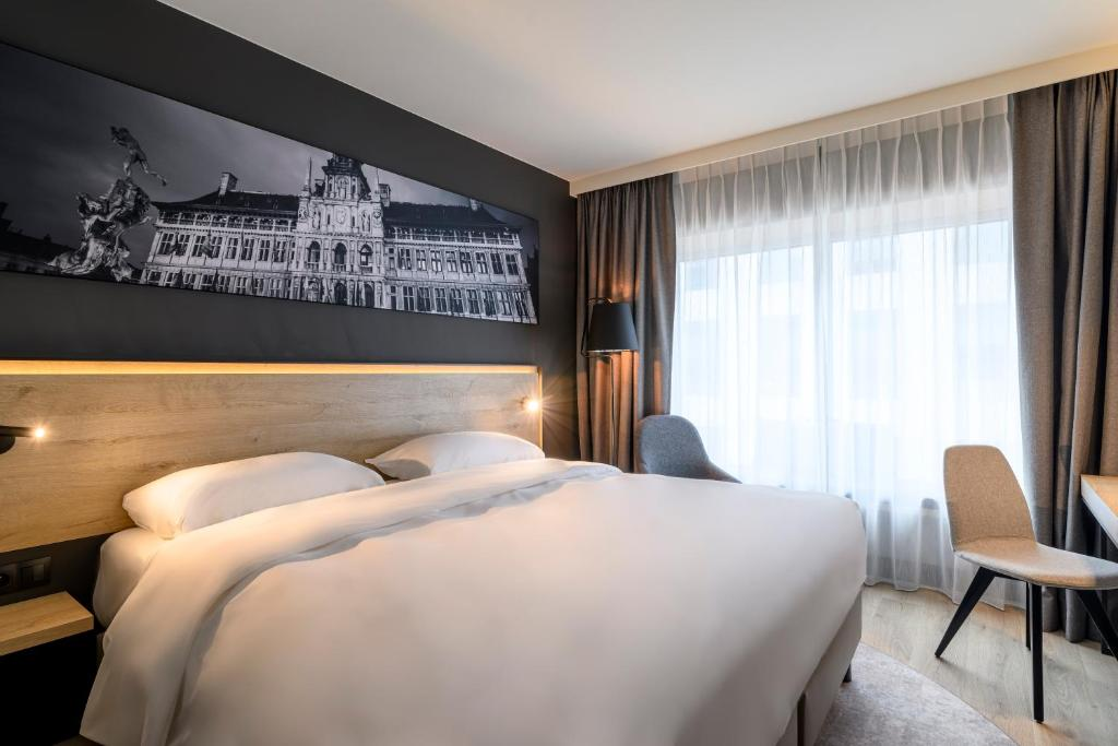 Een bed of bedden in een kamer bij Park Inn by Radisson Antwerp Berchem