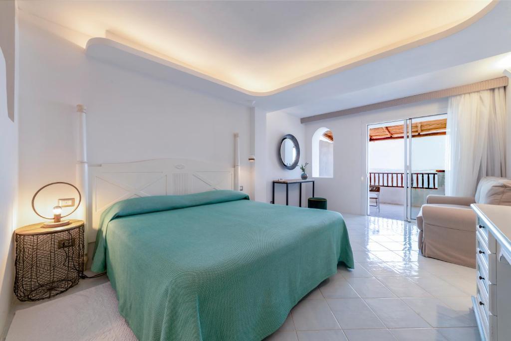 Кровать или кровати в номере Hotel La Bisaccia