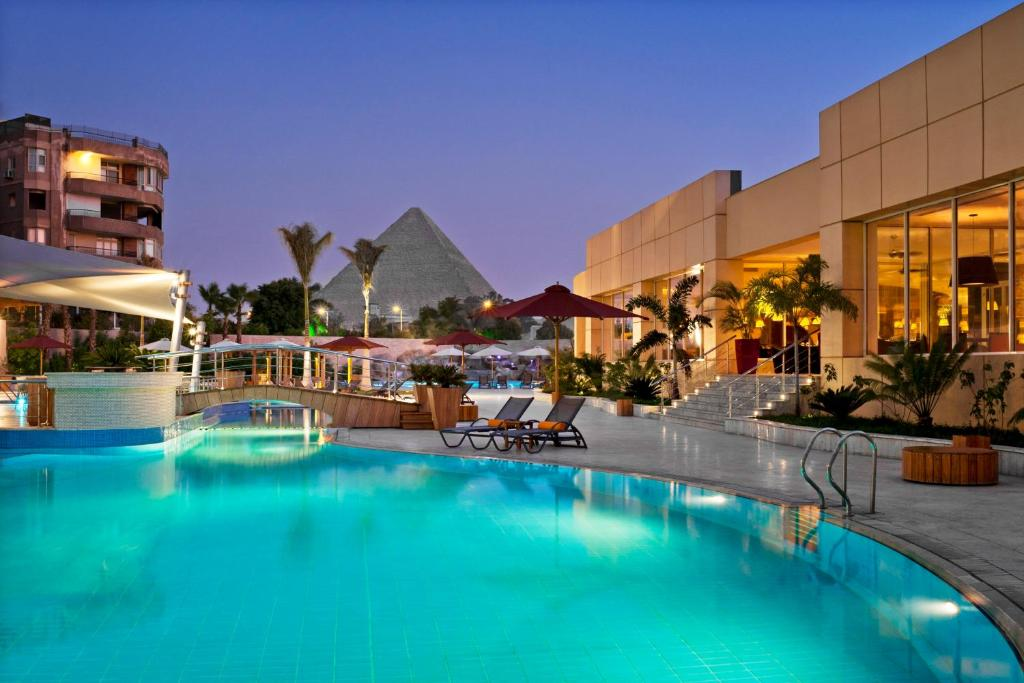 The swimming pool at or near Le Meridien Pyramids Hotel & Spa