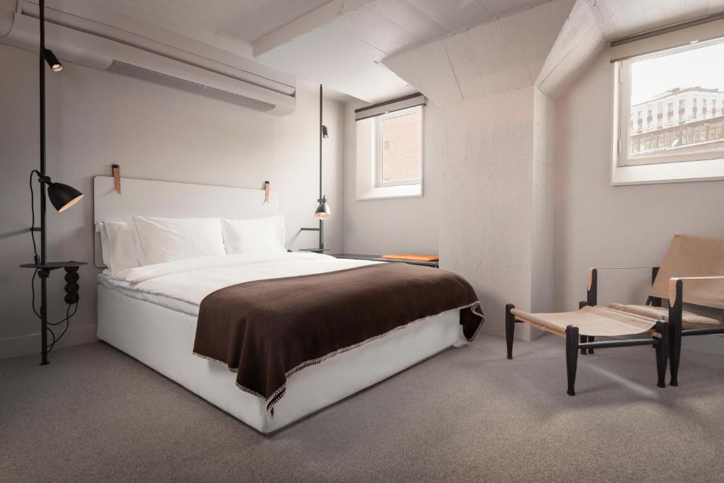 Кровать или кровати в номере Blique by Nobis
