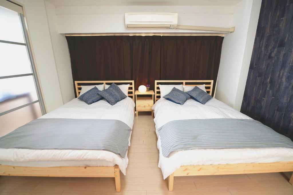 เตียงในห้องที่ Dotonbori Apartment Next JR Namba