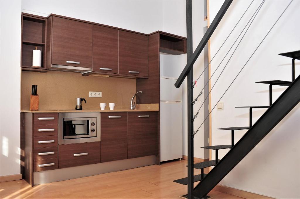 A kitchen or kitchenette at Apartamentos Bejar