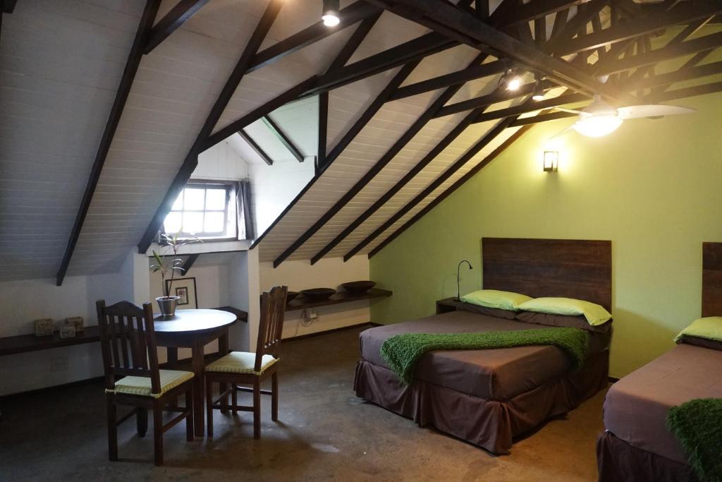 A bed or beds in a room at Casa Cool Beans B&B