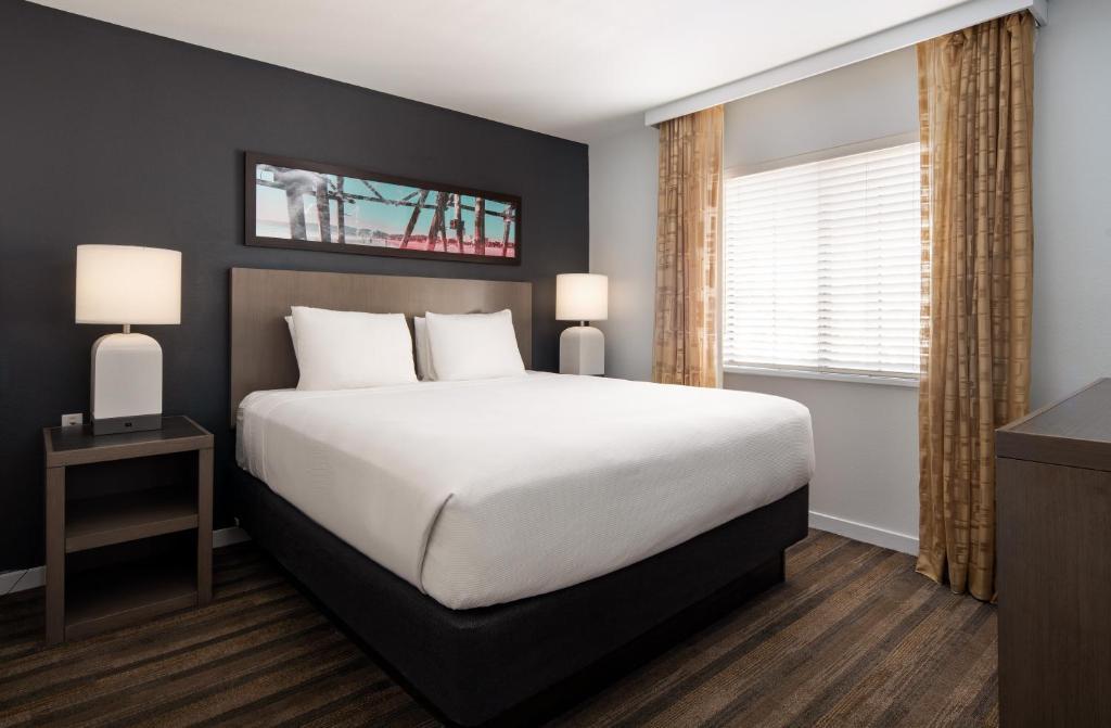 A bed or beds in a room at Hyatt House Denver Tech Center