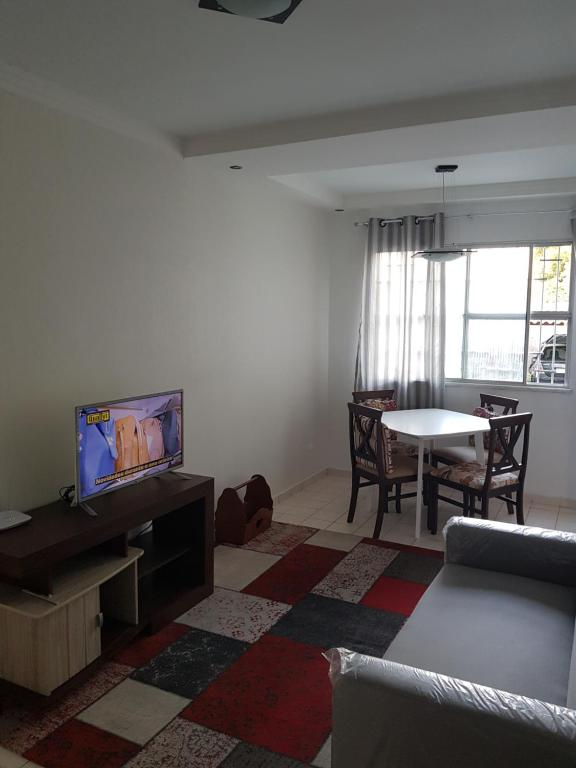 A television and/or entertainment center at Apartamento Aju