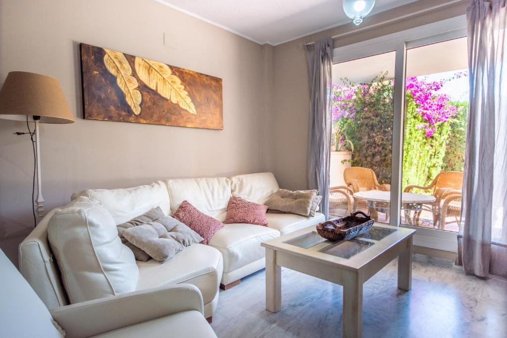 A seating area at Ground floor apartment with private garden next to puerto Banús
