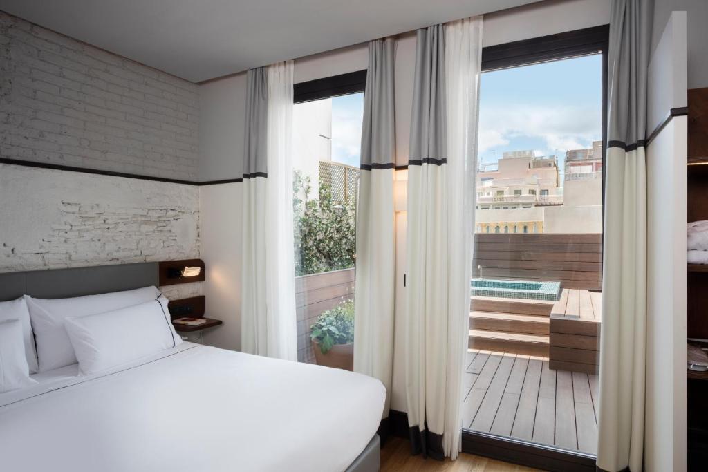 A bed or beds in a room at Praktik Èssens