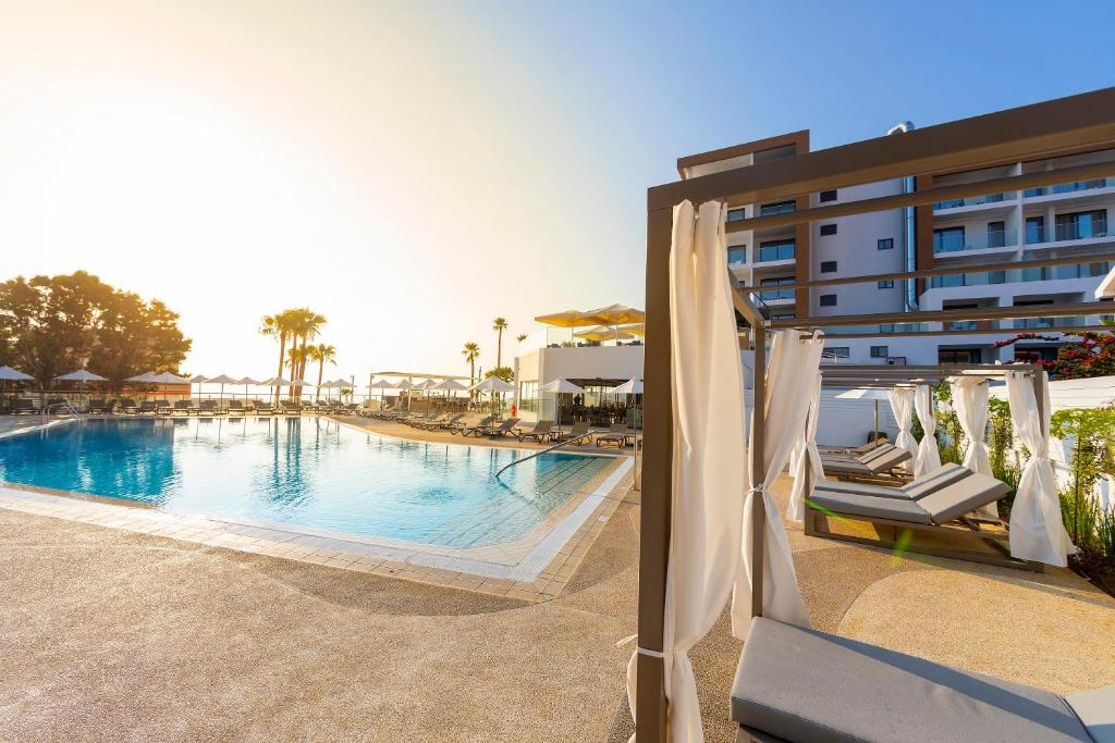 The swimming pool at or near Leonardo Crystal Cove Hotel & Spa – Adults only