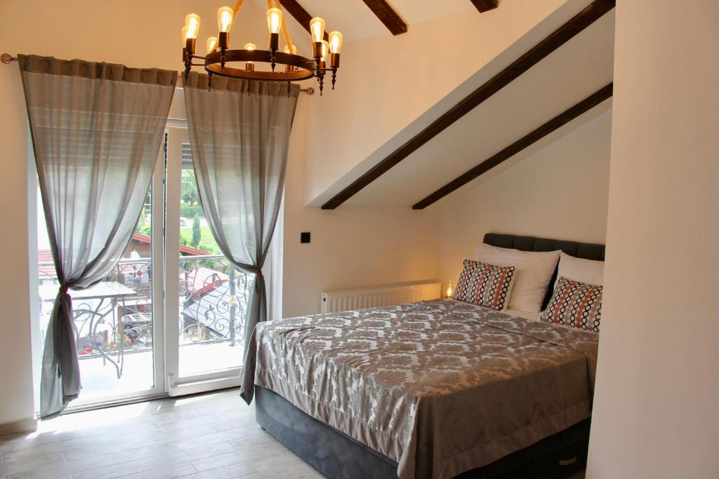 A bed or beds in a room at Villa Waterfalls