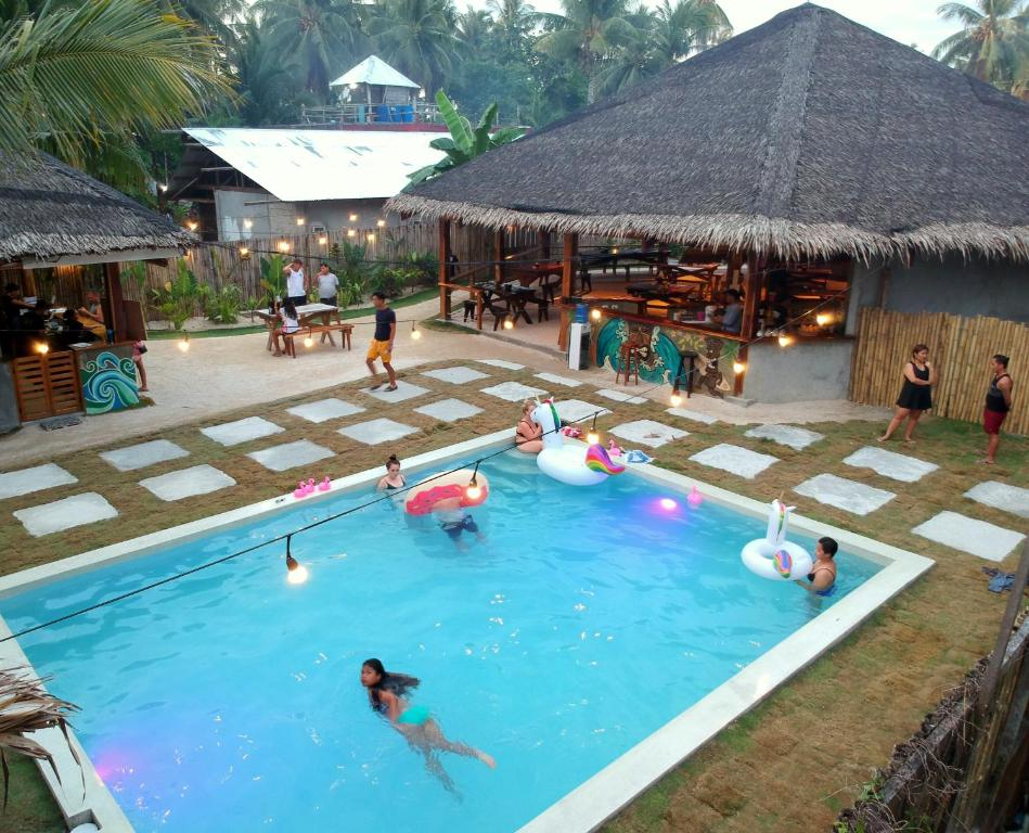 The swimming pool at or near Mad Monkey Hostel Siargao