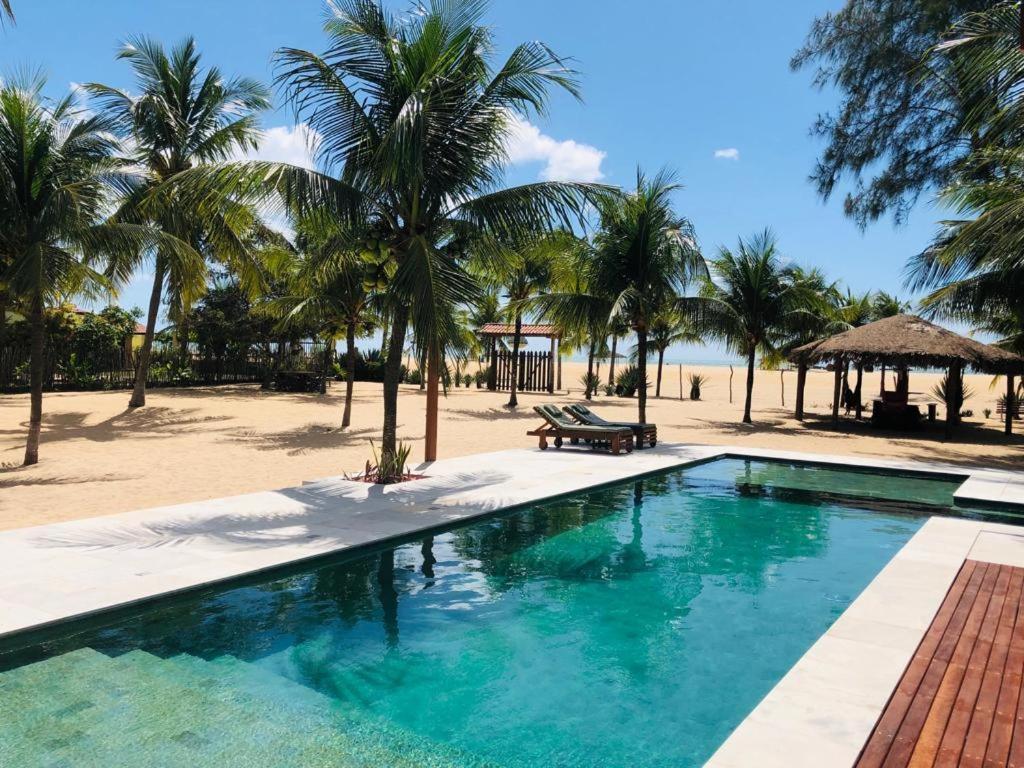 A piscina localizada em Pousada Recanto da Praia ou nos arredores