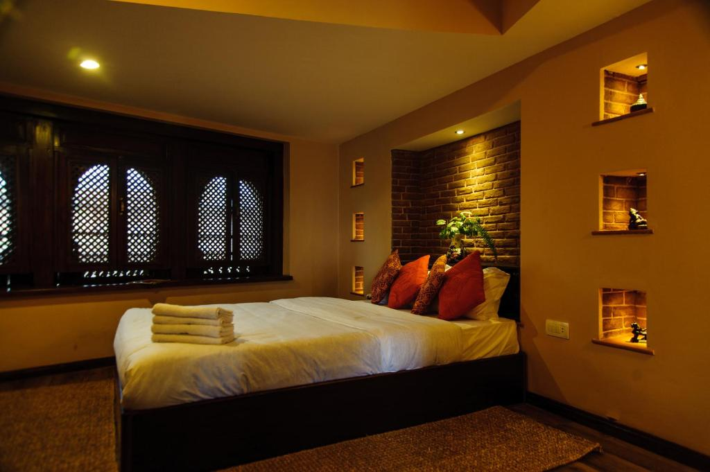 A bed or beds in a room at Thagu Chhen, a Boutique Hotel