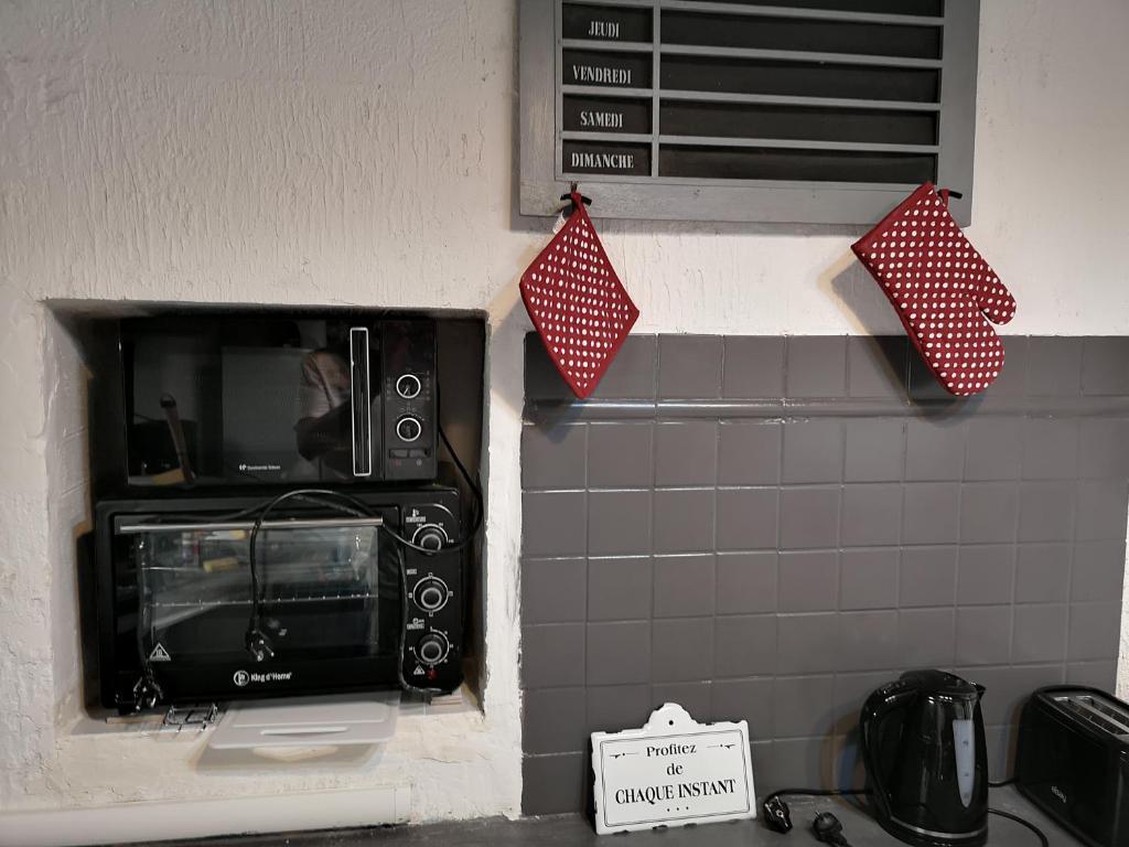 Cuisine ou kitchenette dans l'établissement La Maison des Hautures