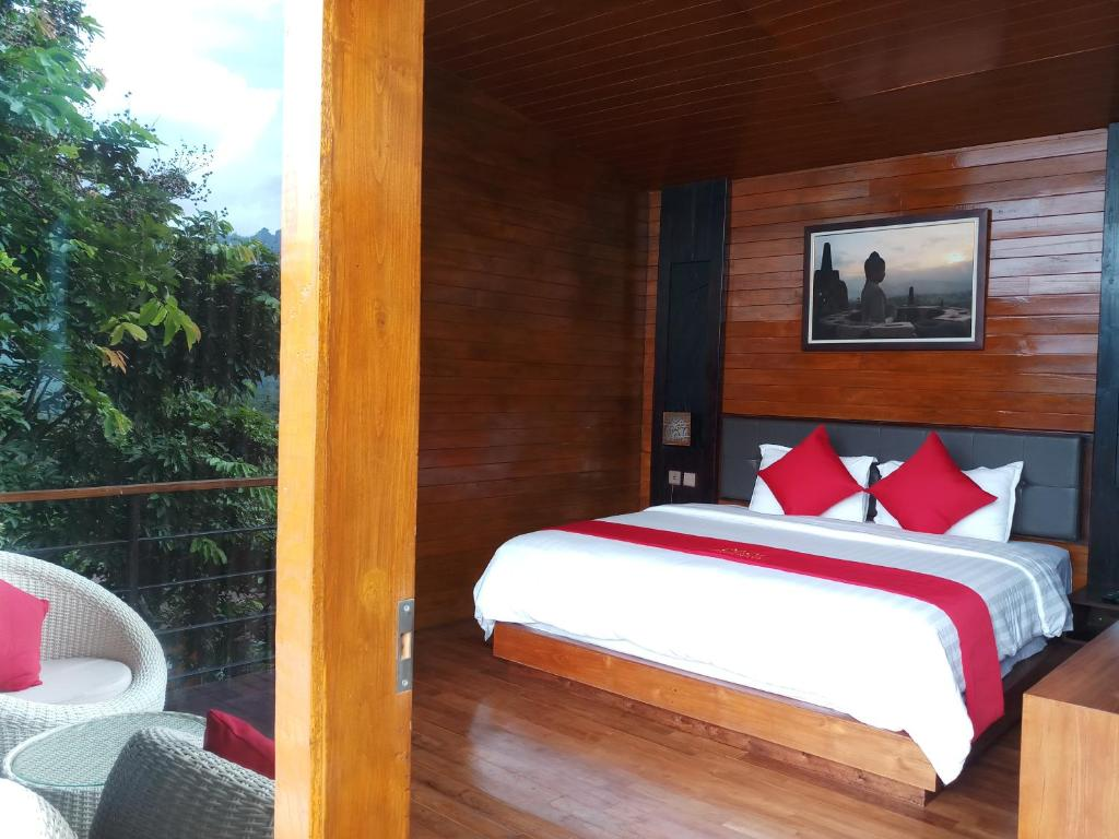 A bed or beds in a room at Manohara Resort