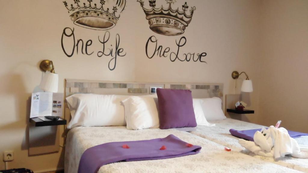 Cama o camas de una habitación en Pensión Úbeda