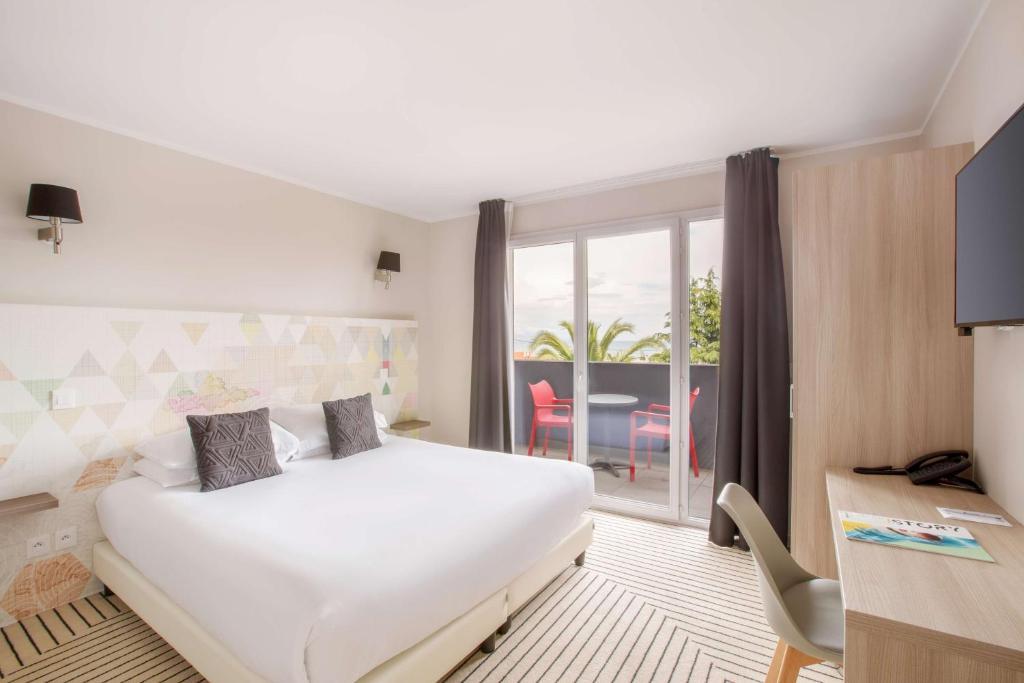 Un ou plusieurs lits dans un hébergement de l'établissement Best Western Plus Antibes Riviera