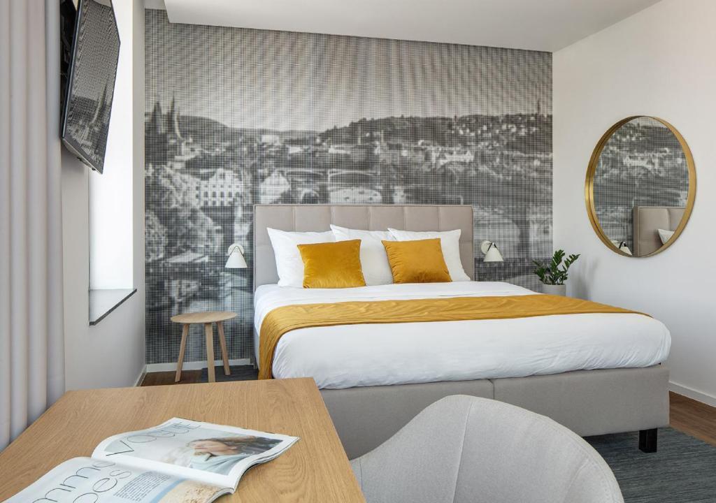Un ou plusieurs lits dans un hébergement de l'établissement Mamaison Residence Downtown Prague