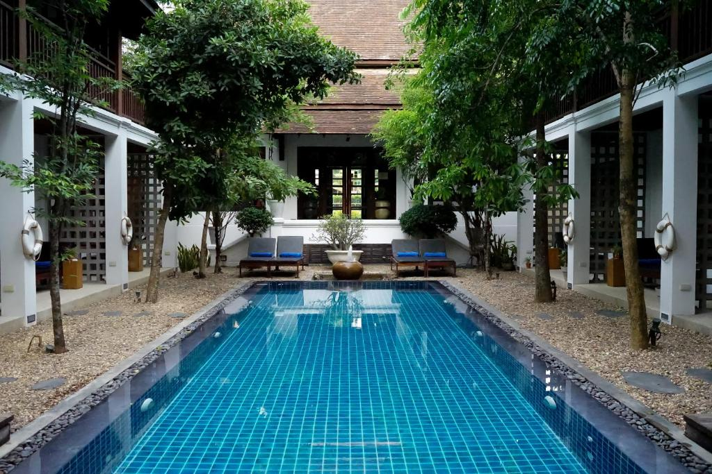 The swimming pool at or near Le Sen Boutique Hotel