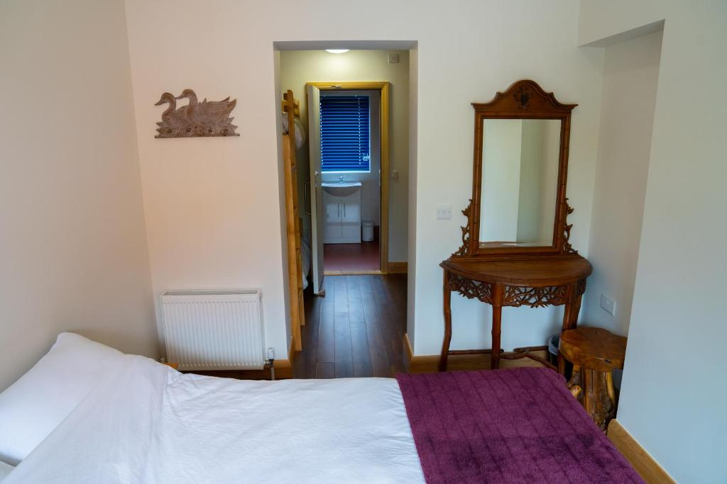 A bed or beds in a room at Ballyhoura Luxury Hostel