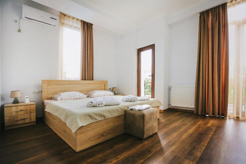 מיטה או מיטות בחדר ב-Balanchine