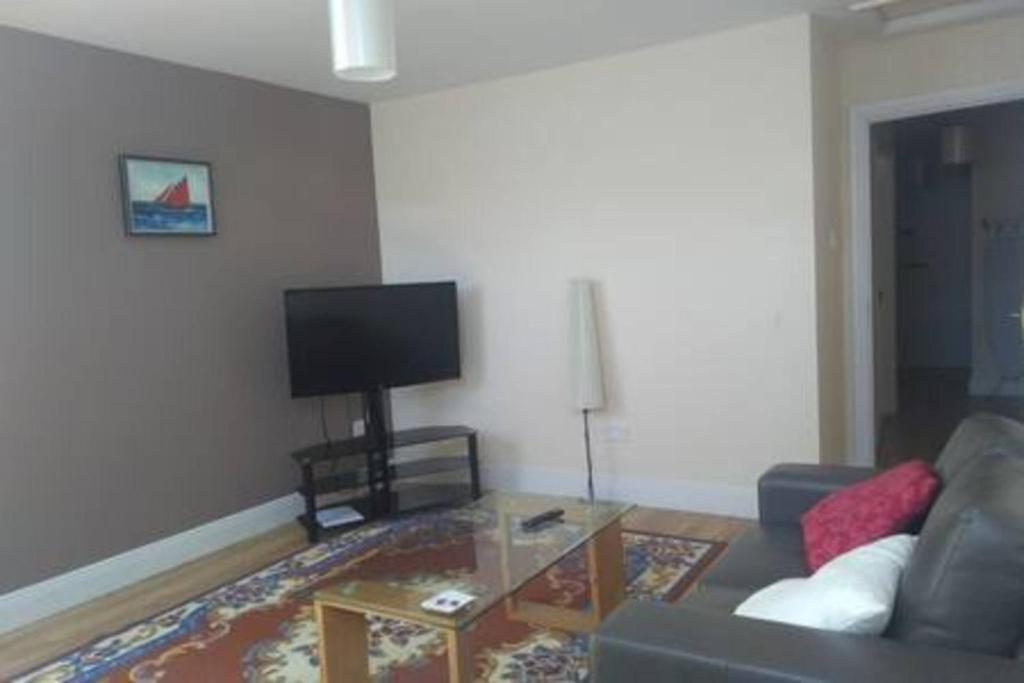 A television and/or entertainment center at Dungarvan Town Centre Apt 3