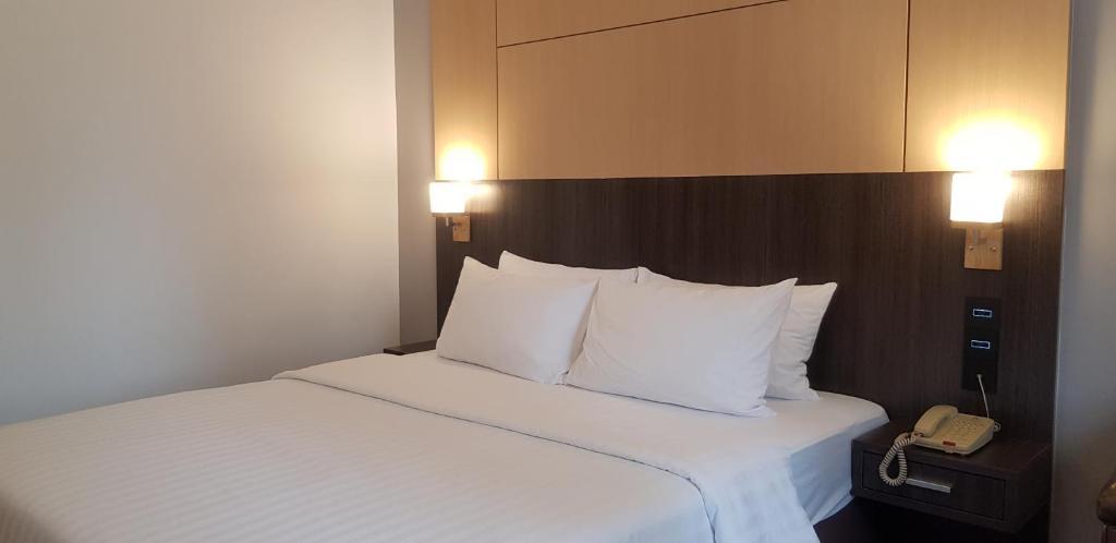 アリストン ホテル バンコクにあるベッド