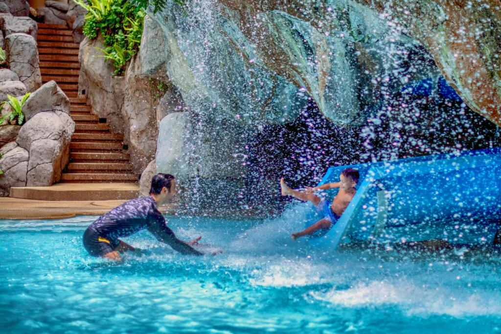 The swimming pool at or near Hilton Phuket Arcadia Resort & Spa