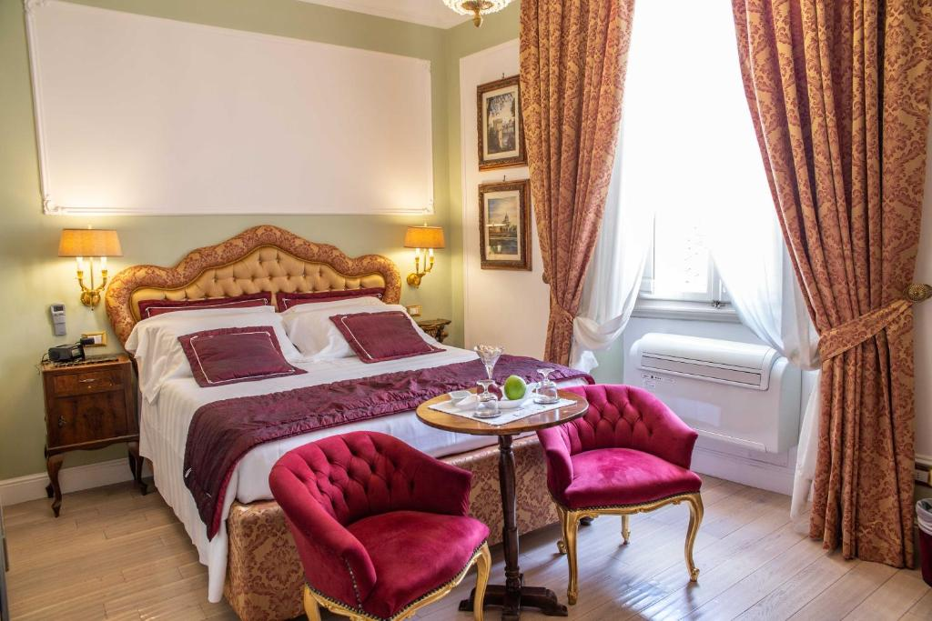 A bed or beds in a room at Stanze del David Place