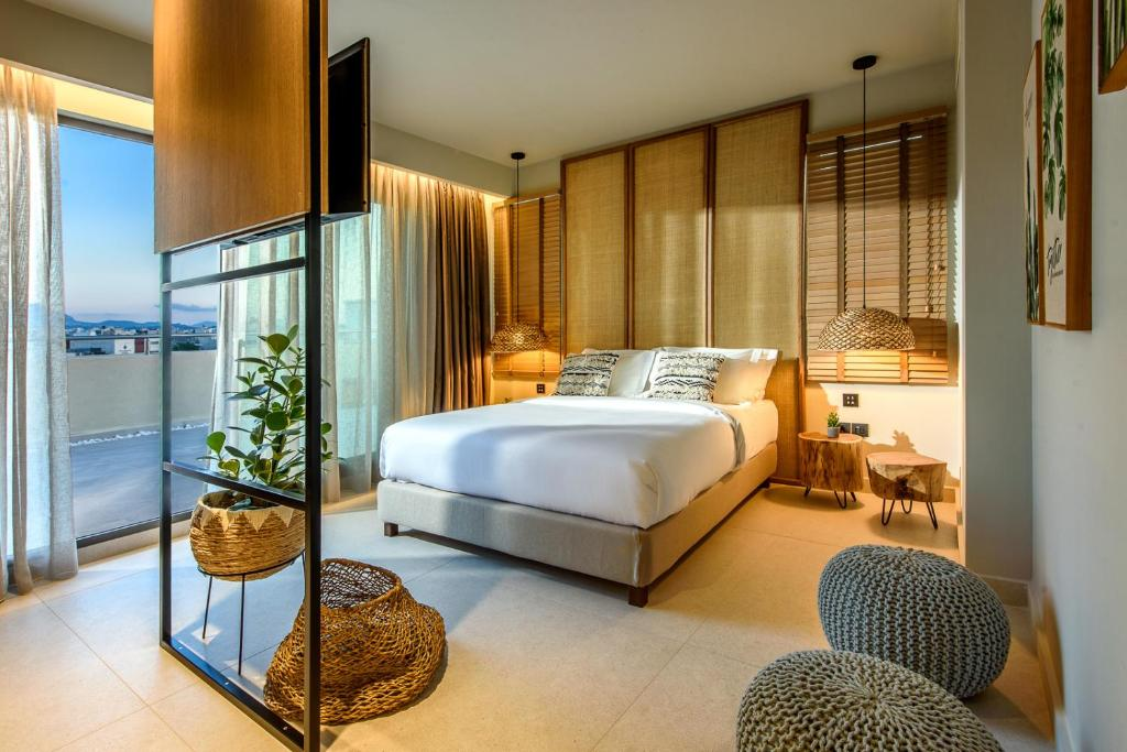 A bed or beds in a room at DOM Boutique Hotel