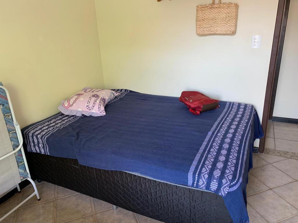 Een bed of bedden in een kamer bij Ed. Dunas House Cabo Frio