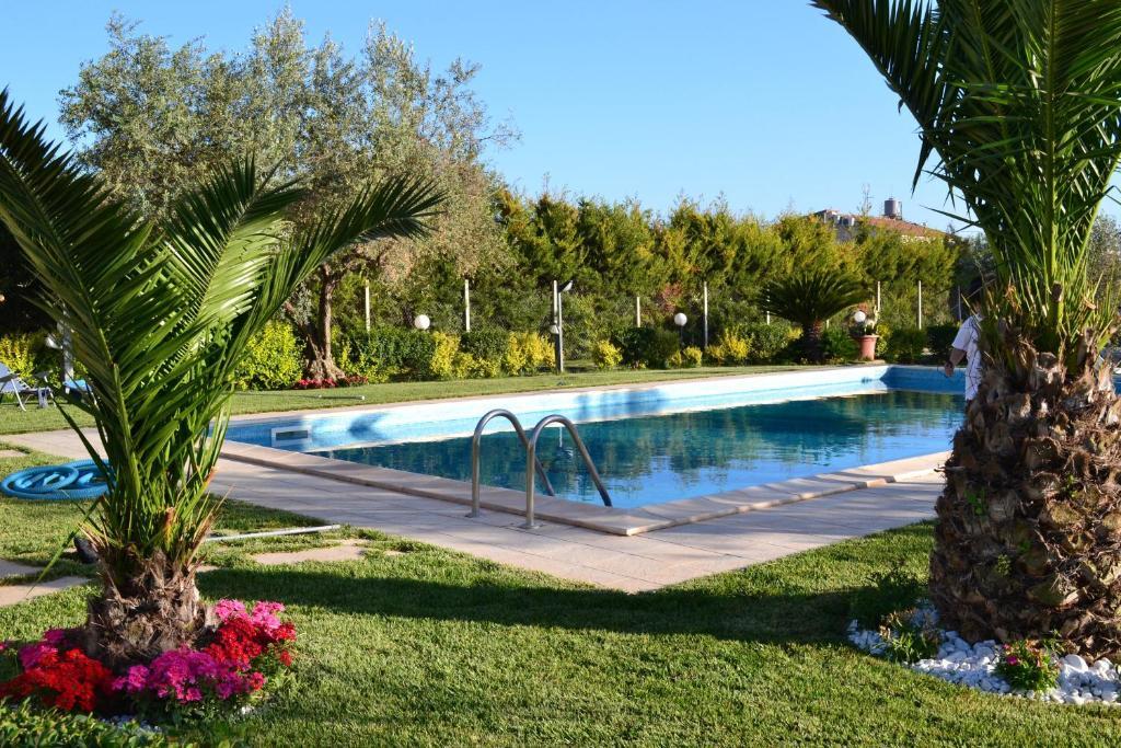 The swimming pool at or near Villa Adriana B&B