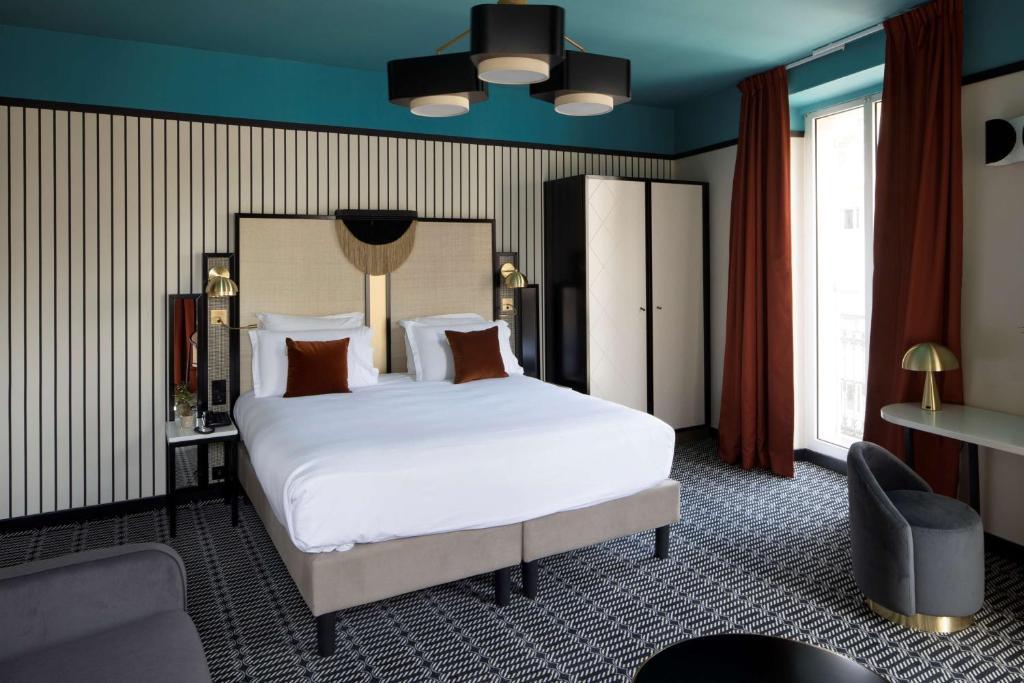 سرير أو أسرّة في غرفة في Best Western Premier Hotel Roosevelt