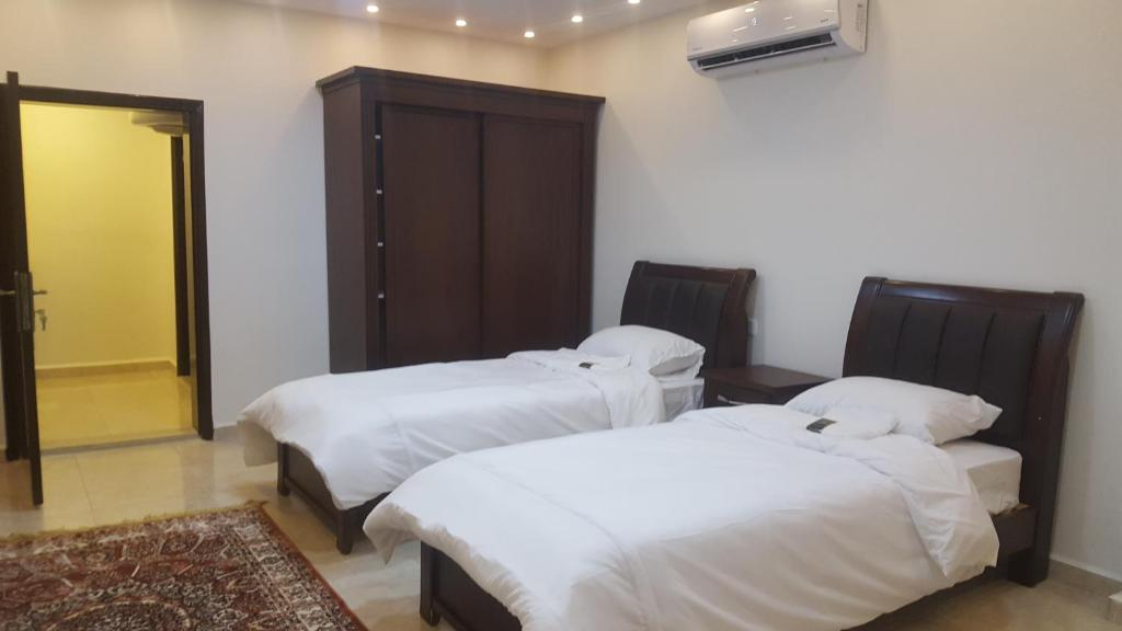 A bed or beds in a room at Sultan Home