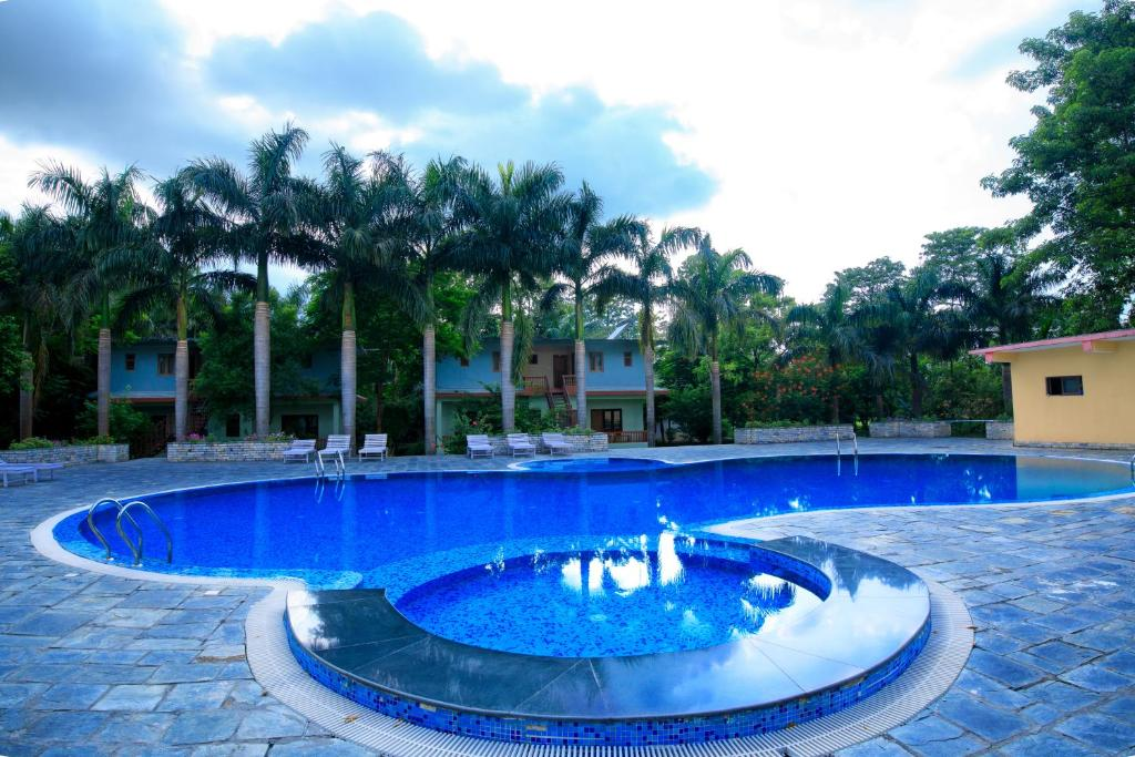 The swimming pool at or near Chitwan Paradise