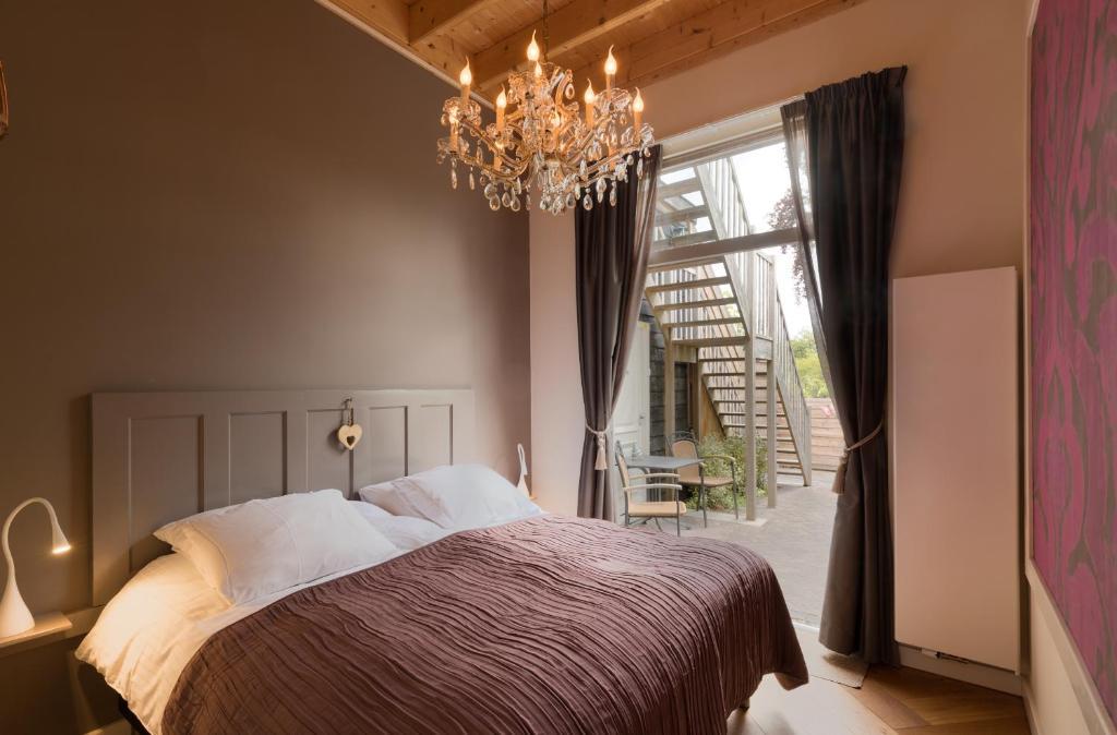 Een bed of bedden in een kamer bij De Gouverneur appartement
