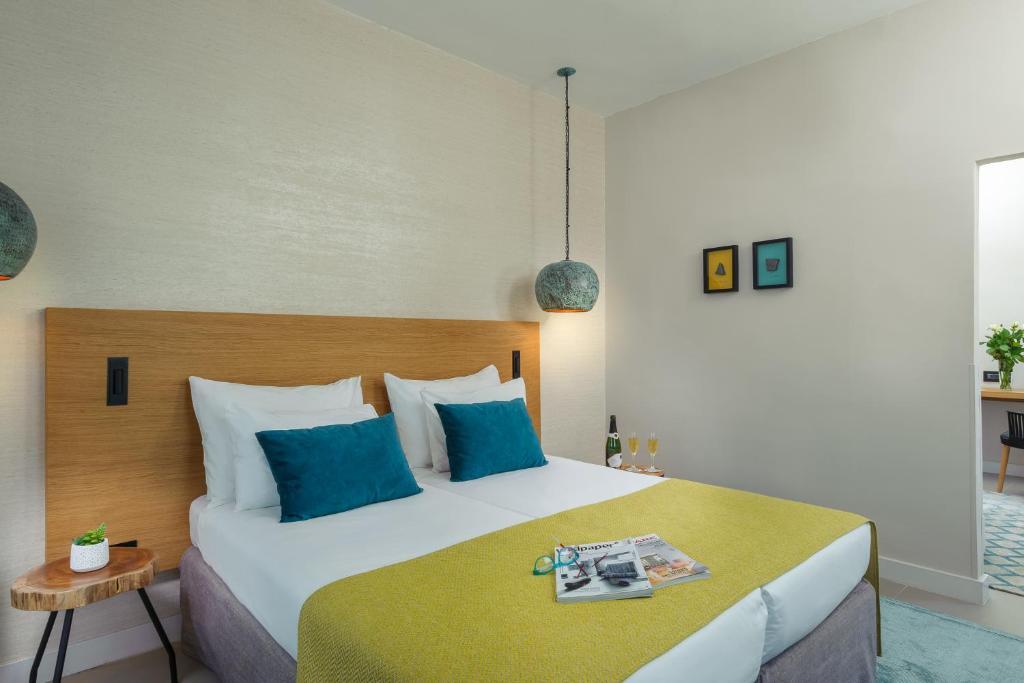 מיטה או מיטות בחדר ב-פרימה גליל