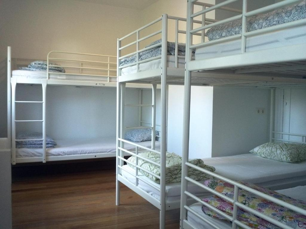 A bunk bed or bunk beds in a room at Xarma Hostel