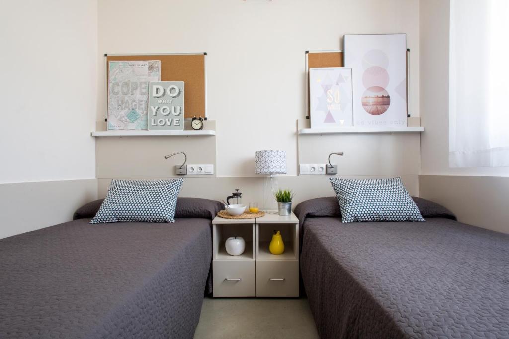 En eller flere senger på et rom på Residencia Universitaria La Salle